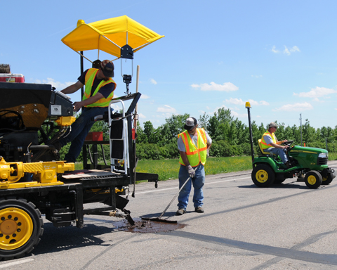 NDDOT Employees fixing cracks on roadway